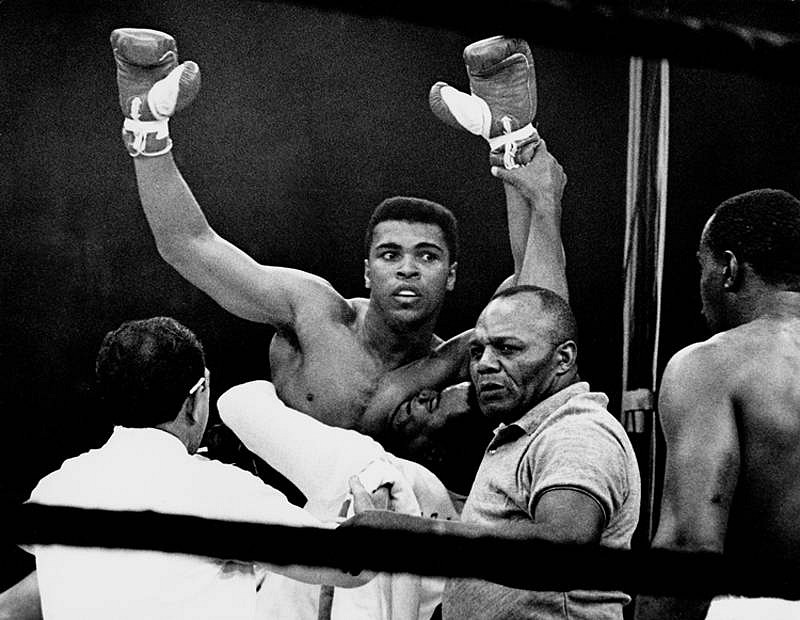 Harry Benson ,   Ali Defeats Liston, Edition of 35  ,  1965     photograph     HB120493