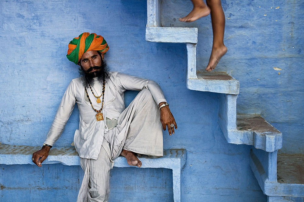 Steve McCurry ,   Man Beneath Stairs  ,  2005     FujiFlex Crystal Archive Print ,  20 x 24 in.     INDIA-10997