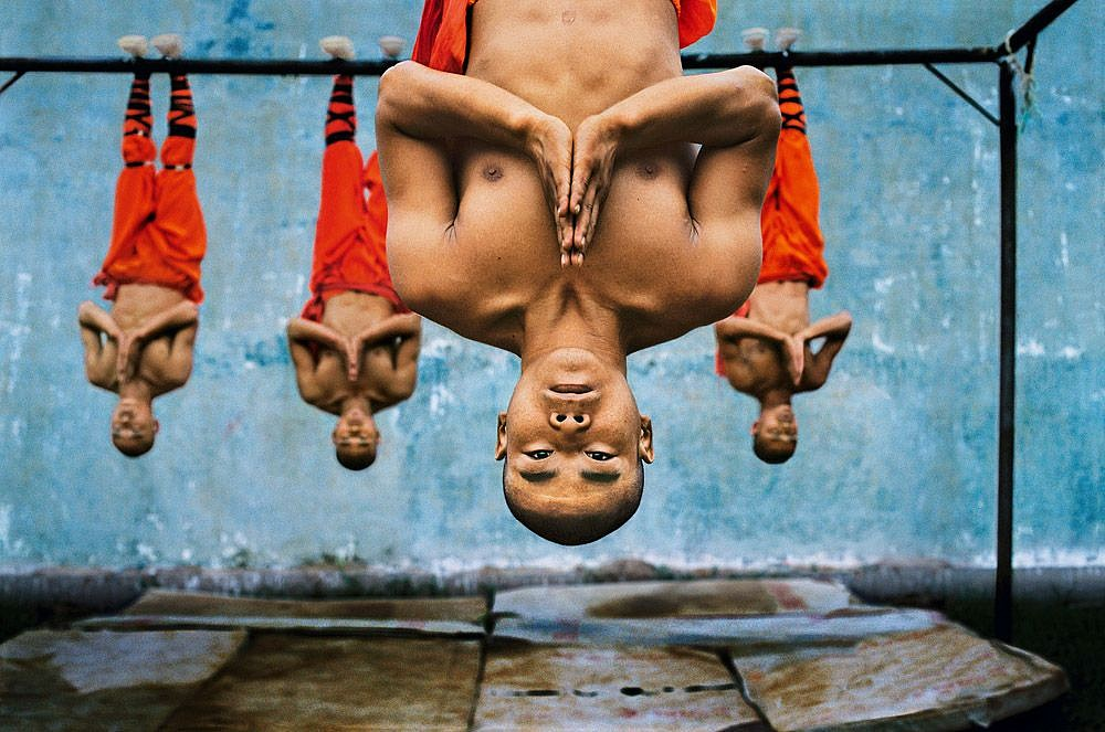 Steve McCurry ,   Shaolin Monks Training, Zhengzhou, China  ,  2004     FujiFlex Crystal Archive Print ,  30 x 40 in. (Inquire for additional sizes)     CHINA-10018NF2