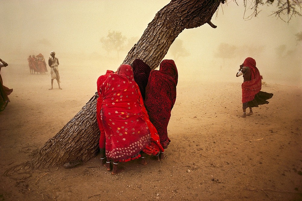 Steve McCurry ,   Dust Storm (Horizontal)  ,  1983     FujiFlex Crystal Archive Print ,  30 x 40 in. (Inquire for additional sizes)     INDIA10003