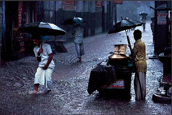 Steve McCurry ,   Man in Monsoon, Ed. 2/6  ,  1983     FujiFlex Crystal Archive Print ,  40 x 60 in.     INDIA10220
