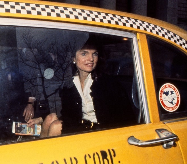 Harry Benson ,   Jackie in Yellow Taxi, NYC, Ed. 15/35      archival pigment print ,  30 x 40 in. (76.2 x 101.6 cm)     HB151106