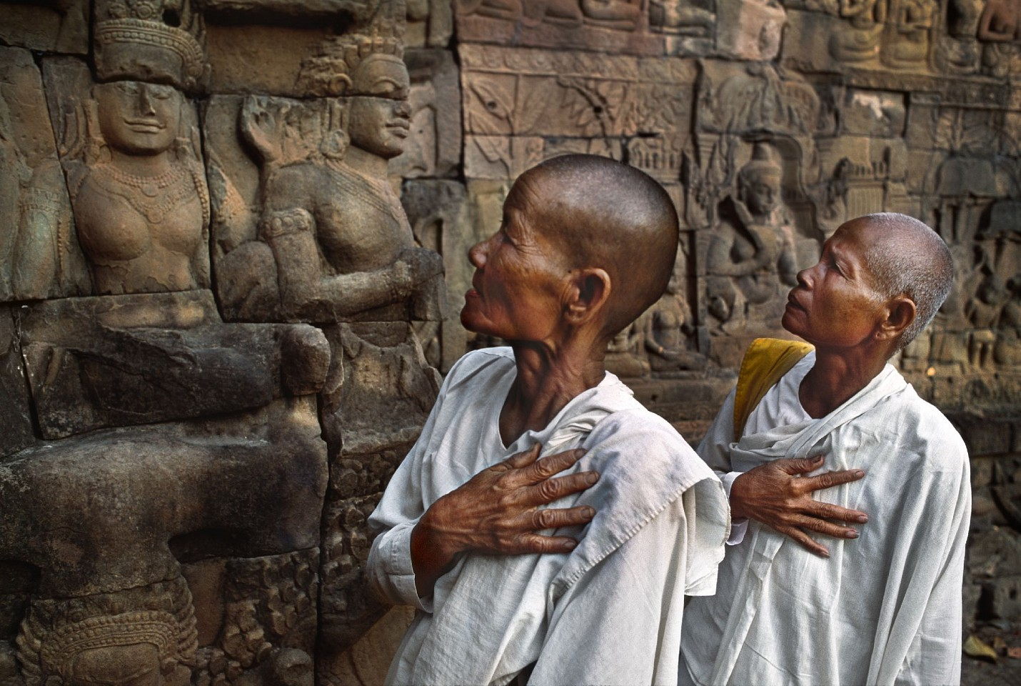 Steve McCurry ,   Buddhist nuns at the Leper King Terrace, Palace Area, Angkor Thom  ,  1998     FujiFlex Crystal Archive Print     Price/Size on request