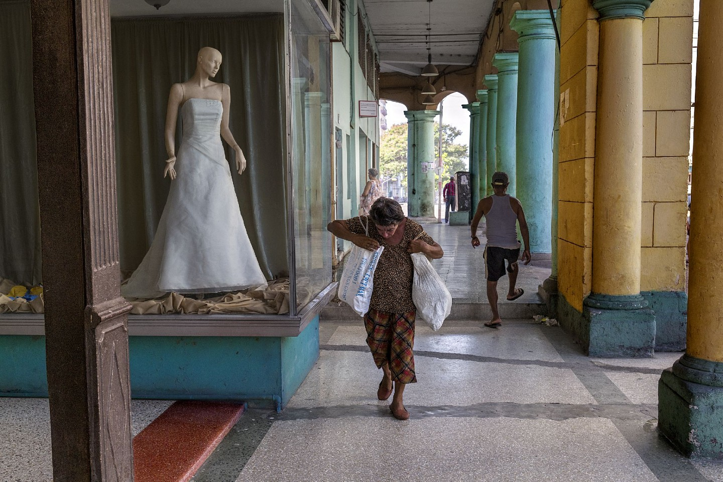 Steve McCurry ,   Woman Walks by Wedding Dress  ,  2019     FujiFlex Crystal Archive Print     Price/Size on request