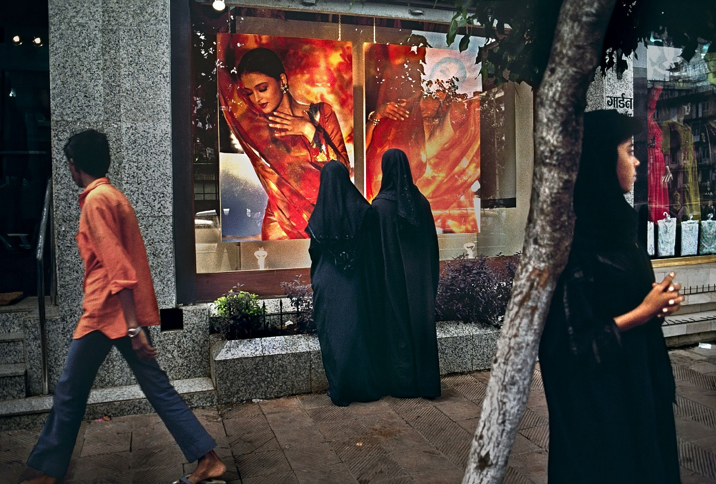 Steve McCurry ,   Woman Stares at Vitrine  ,  1996     FujiFlex Crystal Archive Print     Price/Size on request