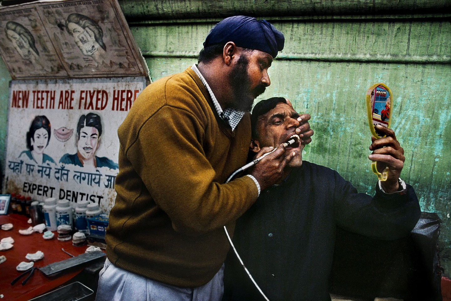 Steve McCurry ,   Street Dentist  ,  1998     FujiFlex Crystal Archive Print     Price/Size on request