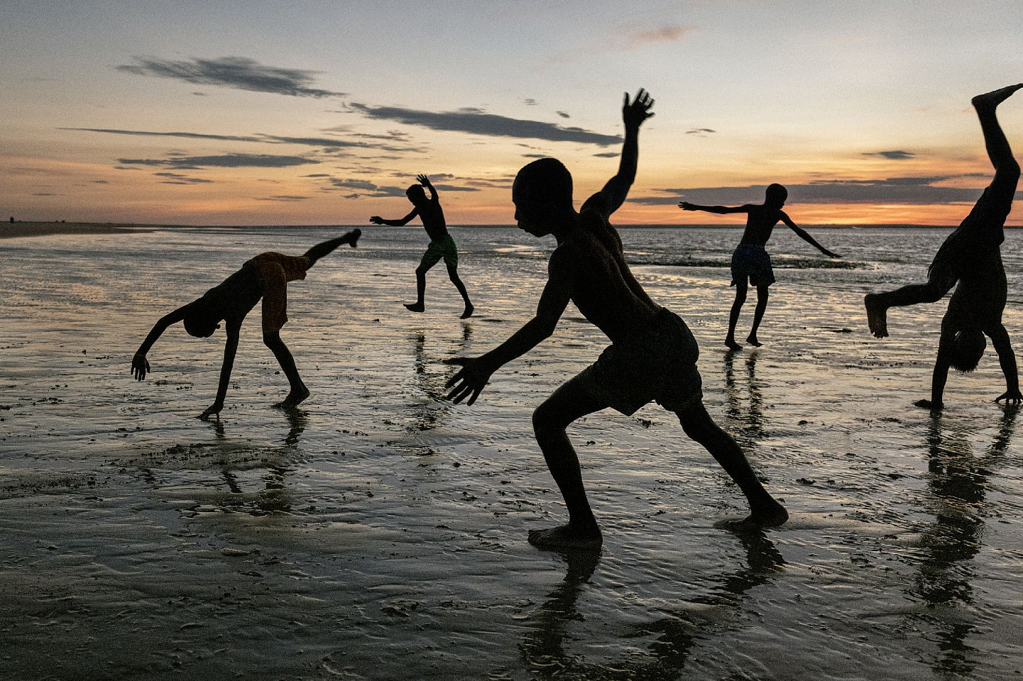 Steve McCurry ,   Kids Play on Beach  ,  2019     FujiFlex Crystal Archive Print     Price/Size on request