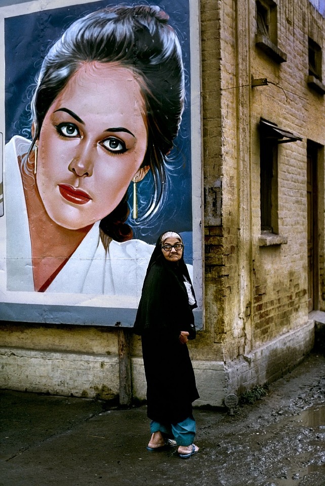 Steve McCurry ,   Woman Outside Rawalpindi Station  ,  1983     FujiFlex Crystal Archive Print     Price/Size on request